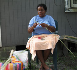 Yvonne Grovner, teaching basket weaving skills.